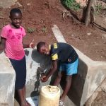 The Water Project: Chandolo Community, Joseph Ingara Spring -  Thumbs Up