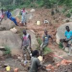 The Water Project: Chandolo Community -  Workers With Gathered Materials For Spring Protection