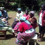The Water Project: Wasenje Community -  Community Members Chat At Training