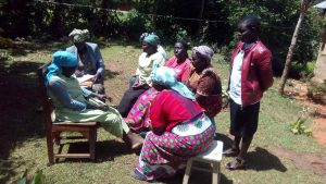The Water Project:  Community Members Chat At Training