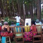 The Water Project: Wasenje Community, Margaret Jumba Spring -  Community Members Listen During Traing