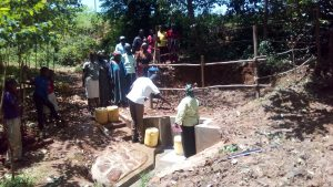 The Water Project:  Learning About Care For Newly Protected Spring