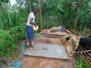 The Water Project:  Cleaning New Latrine Platform