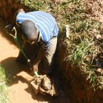 The Water Project: Shiru Community, Sammy Alumola Spring -  Digging At New Spring