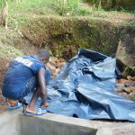 The Water Project: Shiru Community, Sammy Alumola Spring -  Lining Spring Protection