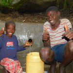 The Water Project: Shiru Community, Sammy Alumola Spring -  Thumbs Up For Clean Water