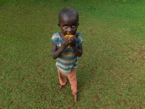 The Water Project:  A Child Enjoying A Fruit At The Training