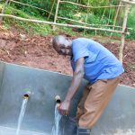 The Water Project: Emwanya Community -  Ainea Bukachi Enjoying Clean Water