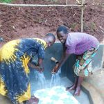 The Water Project: Emwanya Community -  Checking Out Protected Spring