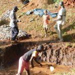 The Water Project: Emwanya Community, Josam Kutsuru Spring -  Clearing Spring For Protection