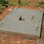 The Water Project: Emwanya Community, Josam Kutsuru Spring -  New Latrine Platform Dries