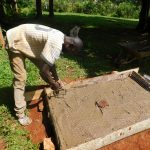 The Water Project: Emwanya Community -  Sanitation Platform Construction