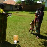 The Water Project: Emwanya Community -  Solar Disinfection Demonstration