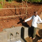The Water Project: Emwanya Community -  Trainer Describes How To Care For The Spring