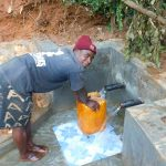 The Water Project: Jivovoli Community -  Collecting Water At New Spring