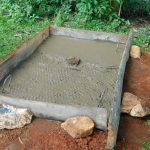 The Water Project: Jivovoli Community -  Sanitation Platform Concrete Dries