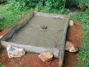 The Water Project:  Sanitation Platform Concrete Dries