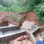 The Water Project: Jivovoli Community -  Spring Protection Nearly Done