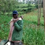 The Water Project: Jivovoli Community, Gideon Asonga Spring -  A Senior Community Member Carrying His Tools After Participating In Harvesting Of Hardcore For Spring Construction
