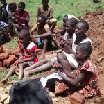 The Water Project: Jivovoli Community, Gideon Asonga Spring -  Children Listenining During Training