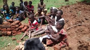 The Water Project:  Children Listenining During Training