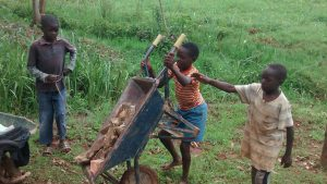 The Water Project:  Community Children Help In Collecting Locally Available Materials