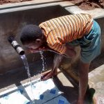 The Water Project: Jivovoli Community, Gideon Asonga Spring -  Drinking Safe Water