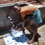 The Water Project: Jivovoli Community, Gideon Asonga Spring -  Safe Water Flowing