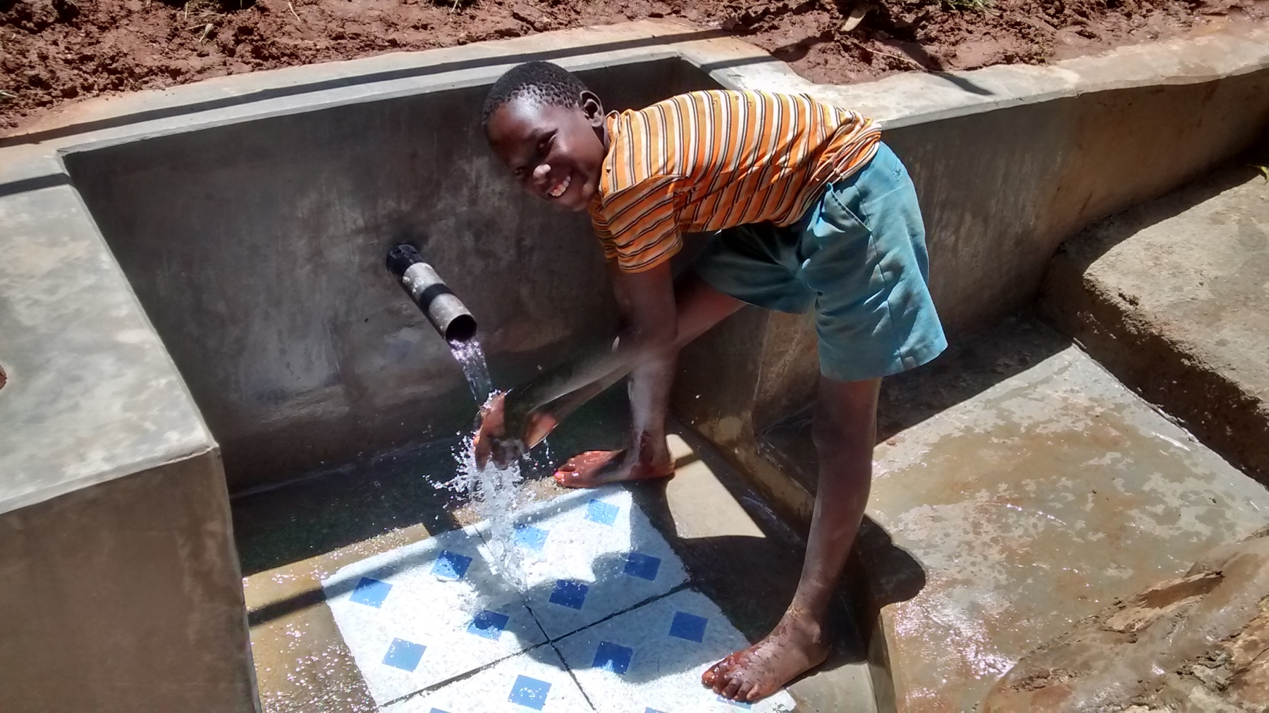 The Water Project : kenya18105-safe-water-flowing