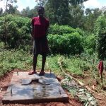 The Water Project: Jivovoli Community, Gideon Asonga Spring -  Standing On New Latrine Platform
