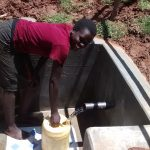The Water Project: Jivovoli Community A -  Collecting Water From New Spring