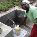 The Water Project: Ingavira Community -  Collecting Clean Water