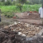 The Water Project: Ingavira Community, Laban Mwanzo Spring -  Laying Rock At Spring
