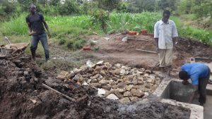 The Water Project:  Laying Rock At Spring