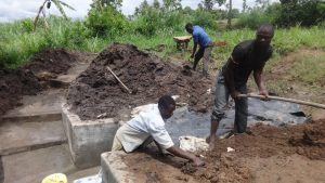 The Water Project:  Preparing Ground Around Spring