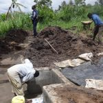 The Water Project: Ingavira Community, Laban Mwanzo Spring -  Spring Box Construction