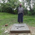 The Water Project: Ingavira Community, Laban Mwanzo Spring -  Standing At New Latrine