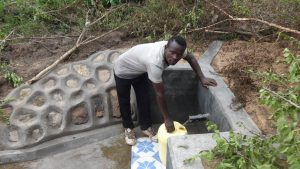 The Water Project:  Collecting Water From Protected Spring