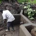 The Water Project: Masera Community -  Digging Out Spring Bottom