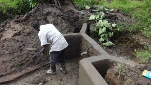 The Water Project:  Digging Out Spring Bottom