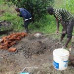 The Water Project: Masera Community -  Mixing Cement