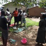 The Water Project: Masera Community, Ernest Mumbo Spring -  People Participate In Training Demonstration