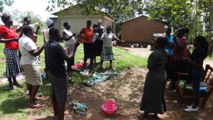 The Water Project:  People Participate In Training Demonstration