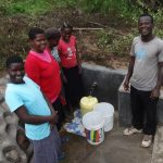 The Water Project: Masera Community, Ernest Mumbo Spring -  Posing Around Protected Spring