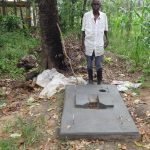 The Water Project: Masera Community, Ernest Mumbo Spring -  Posing With New Sanitation Platform