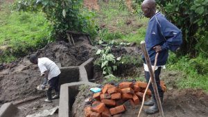 The Water Project:  Preparing Bricks