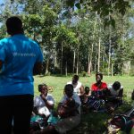 The Water Project: Masera Community -  Trainer Speaking To Community Members