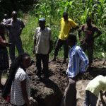 The Water Project: Masera Community A -  Community Members Inspect Completed Spring