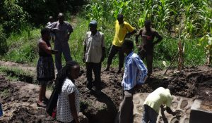 The Water Project:  Community Members Inspect Completed Spring