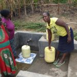 The Water Project: Masera Community A -  Fetching Safe Water